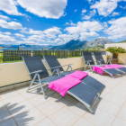 Relax on the Rear Balcony with a Fantastic View across the Mountains and Orange Groves.