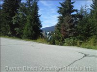Across Street Path Leading to Blackcomb Chairlifts (200metres) and Notice Fairmont Chateau Whistler Thru the Trees