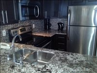 Fully Upgraded Kitchen with Granite Countertops and Stainless Steel Appliances.