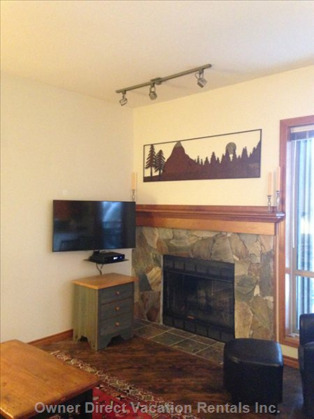 Wood Burning Fireplace with Flat Screen Smart hd Tv