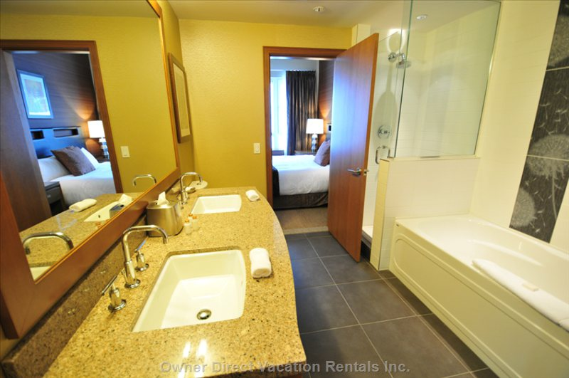 Bathrooms with Dual Vanities, Separate Showers and Tubs.