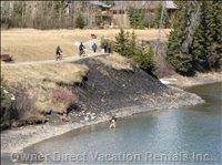 Bow River Activities - one Picture Captures Biking, Walking, and Fly Fishing... all along the Bow River!