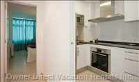 Fully Equipped Kitchen, with Dishwasher, Microwaves, Induction Plates and Big Fridge.