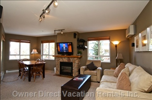 Spacious Living Room with Sofa Bed and Lcd Tv. Views of Whistler and Blackcomb Mountains from your Couch!