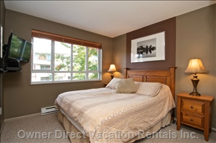 Comfy Queen Bed. Bedroom has Tv and Views of Whistler Blackcomb Mountains.