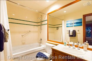 Master Ensuite - Complete with Jetted Jacuzzi Tub, Shower and Complimentary Shampoo and Gel.