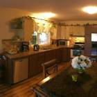 Kitchen has Stainless Steel Appliances, Pots, Pans, Dishes and all Needed Kitchen Amenities
