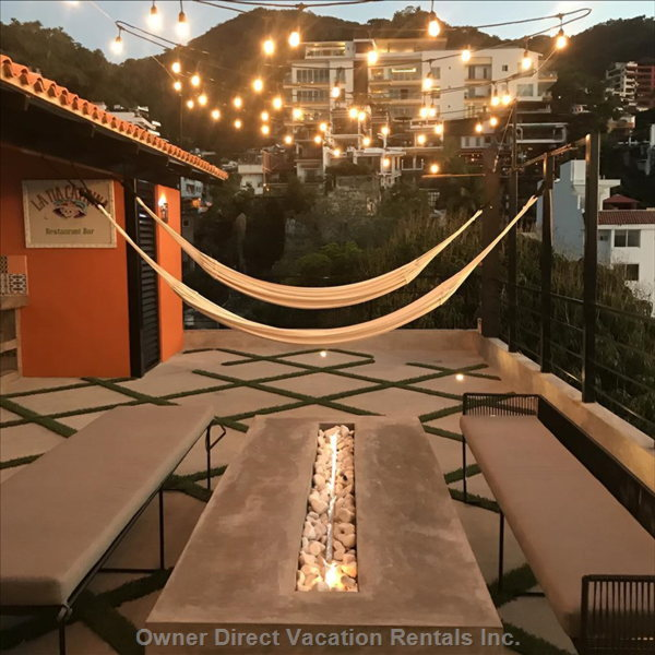 Rooftop Hammock Lounge & Fire Pit. All of the Lights Turn on at 7pm until 3am. It is so Gorgeous up Here at Night.