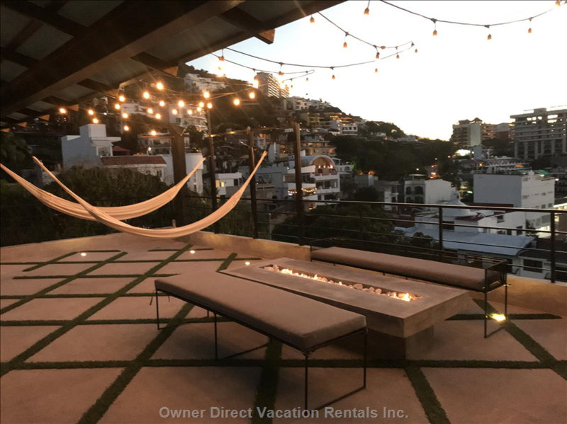 Hammock Lounge & Fire Pit. All of the Lights Turn on up Here at 7pm until 3am.