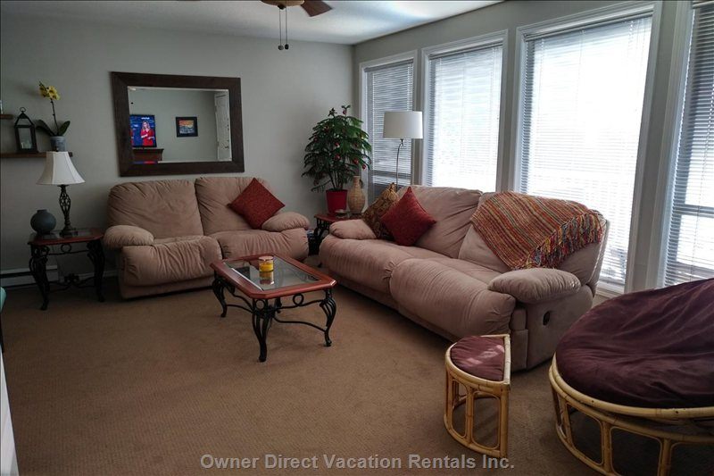 Bright, Spacious Living Room; Large Windows with Breathtaking View of the Mountains!