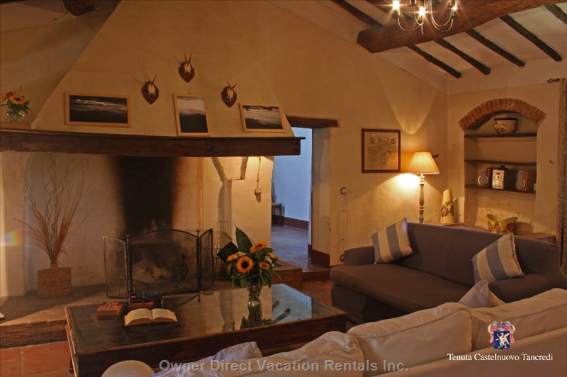 The Typical Tuscan Farmhouse Living Room with Sit-in Fireplace and Indian Coffee Table