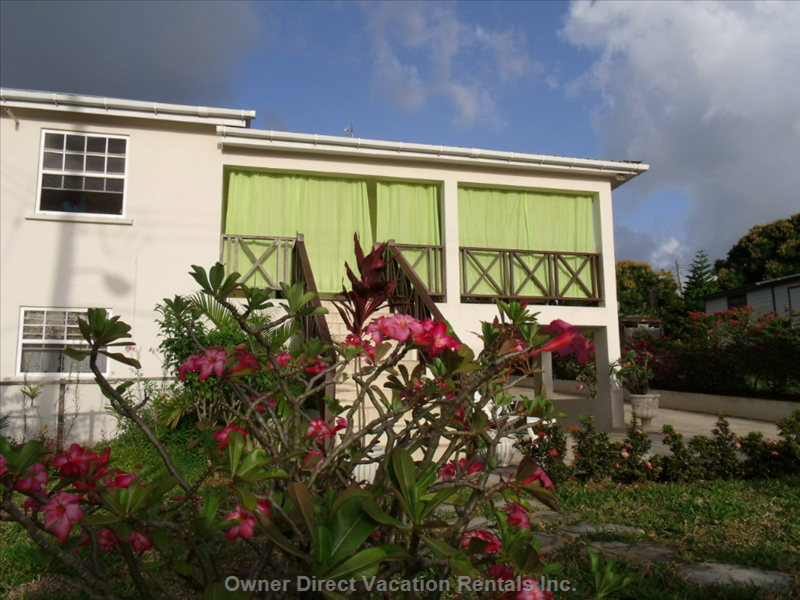 Authentic Bajan Scenery, Natural Tropical Spaces, Gardens, all Set around a Lower Level Suite with Breezeway.