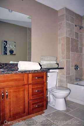 En Suite with Soaker Tub with Granite & Travertine