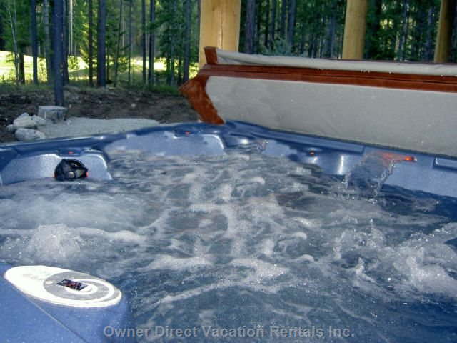 Private Hot Tub that Looks out Peacefully to the Tall Pines and Trickle Creeks 16th Hole