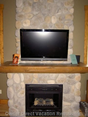 "42"" Hd TV Mounted on River Rock Fireplace"