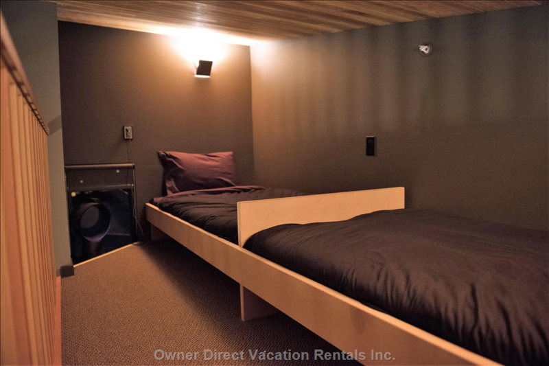 Each of the Lofts in the Guest Bedrooms Have Two Twin Beds, with Storage Underneath.