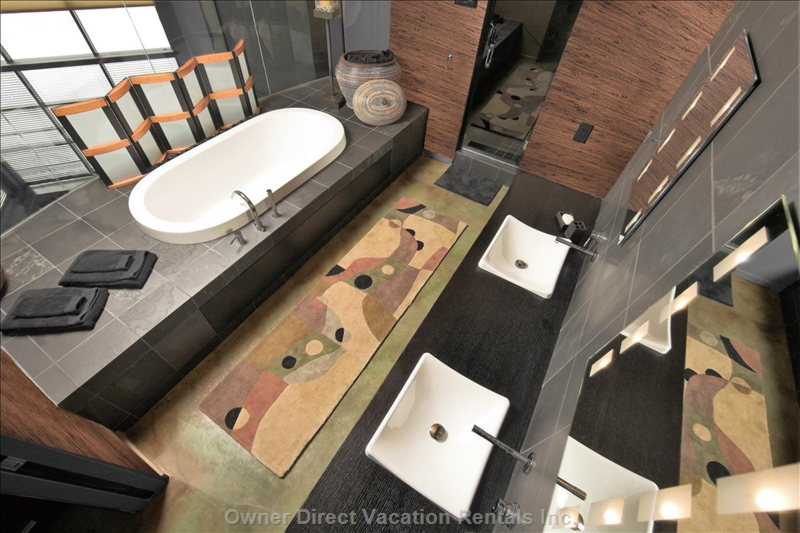 The Ensuite has Two Sinks, a Two-Person Steam-Shower, and a Two-Person Jetted Tub.