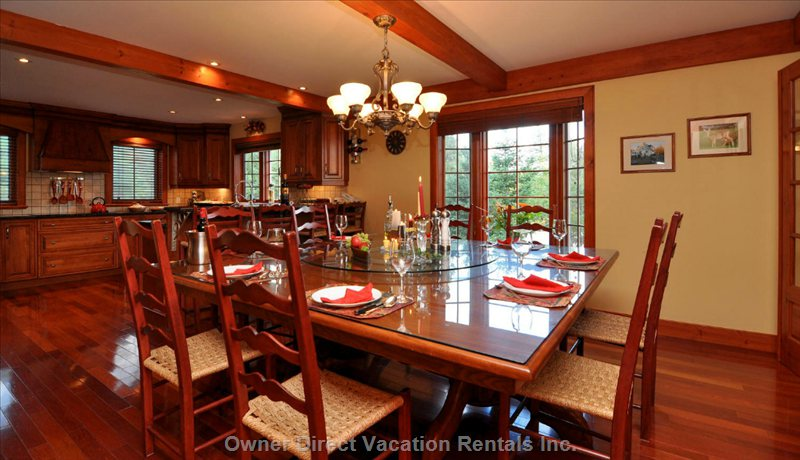 Dining Table Seats up to 16, plus 4 at Kitchen Bar Counter, and 4 more in the Adjoining Sunroom.