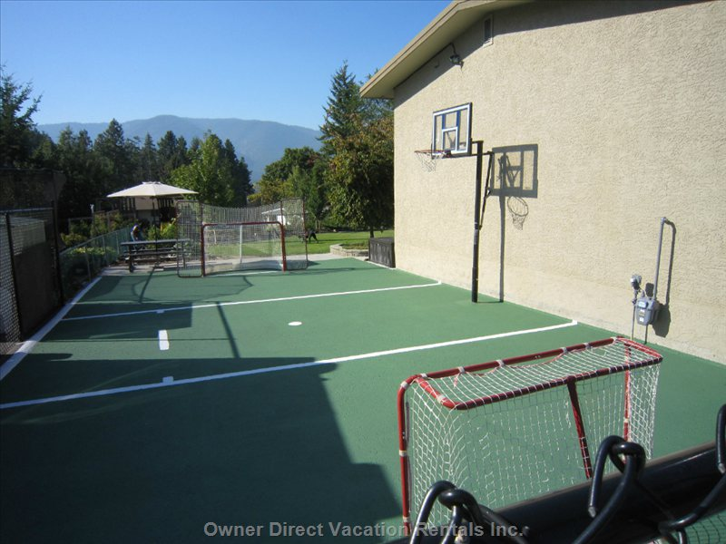 Enjoy Basketball Or Road Hockey on the Sports Court at the Side of the House.