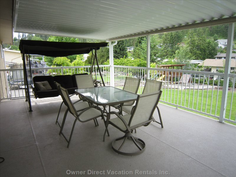 Enjoy a Meal Or a Drink on the Large Covered Deck Overlooking the Backyard.
