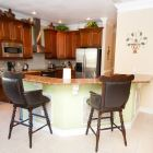 Fully Equipped Kitchen with Upgraded Cabinets and Stainless Steel Appliances