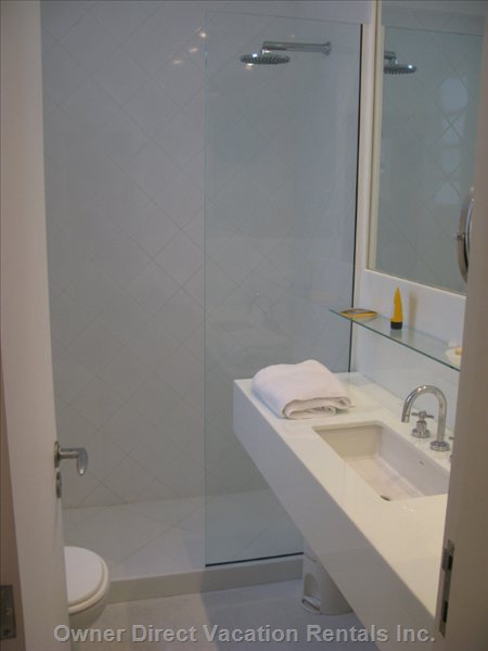 The Bathroom is in Fact a Shower Room, There is no Tube, but in White Marble with all Amenities (Hairdryer, Magnifying Mirror Etc..)