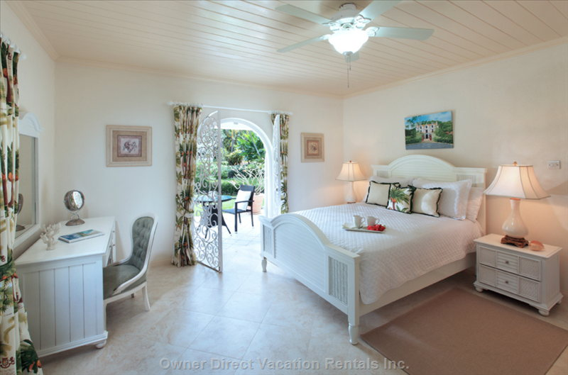 Bedroom Suite in the Main House Opens out on to the Garden with a Table and Chairs for Relaxing