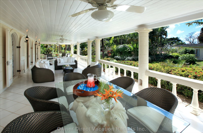The Cottage has a Large Covered Patio with Comfortable Seating and Dining for up to 6