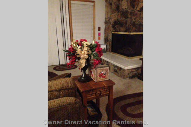 Holiday Floral Arrangement in Living Room. Flat Screen Tv with Wifi and Dvd Player.