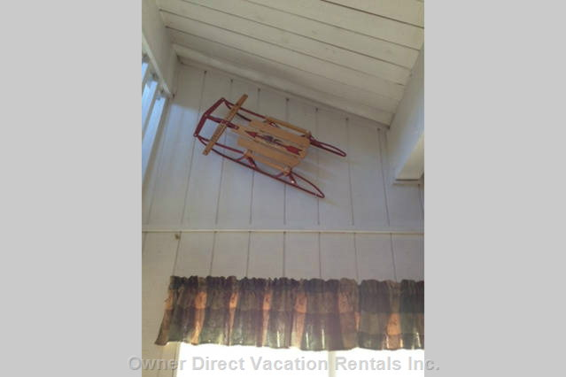 Hanging Sled on Wall in Vaulted Ceiling in the Living Room, Reminds us How Fun it is to Play in the Snow!