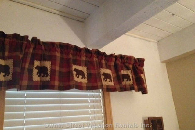 Bear Accents Add to the Cabin Feel in the Master Bedroom.