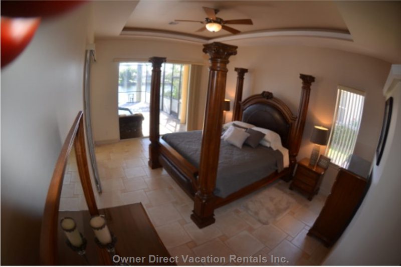 Master Suite # 1. With King Bed, Doors to Pool Area.
