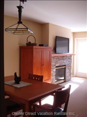 Dining Area, Armoire and Gas Fireplace with 42-Inch Lcd TV