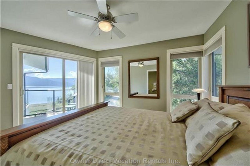Upper Floor Master Bedroom with a View of the Lake and Provincial Park
