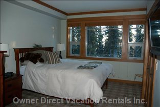 Master Bedroom  #1 - Queen Bed, TV with DVD Player, Covered Deck Shared with other Master Bedroom.