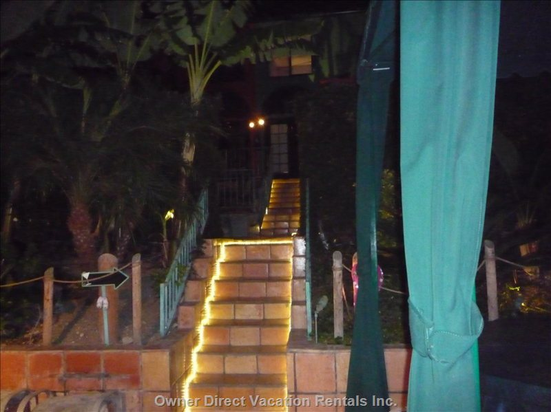 Night View of Rope Lit Staircase Leading to Spanish Hacienda and Hollywood Loft