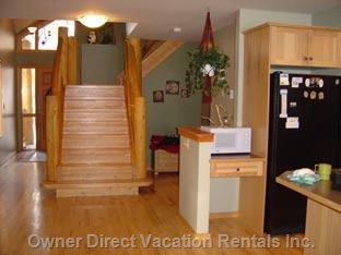 Stairway to Upstairs; Full Kitchen on Right, Hardwood Floors