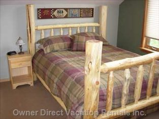 Queen Log Bed in Front Bedroom.
