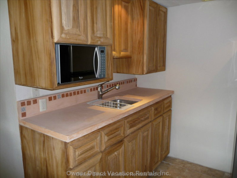 Concrete Counters & Microwave in Kitchen