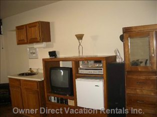 Room Features, Fridge, Extra Sink,  Coffee Pot, Tea Pot, Kettle, Dishes and Wine Glasses and Flat Screen T.V. With Cable
