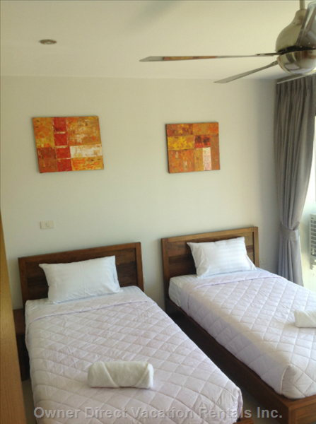 Rear Bedroom has Twin Single Beds and En Suite with Shower, Balcony Overlooks a Cocnut Orchard