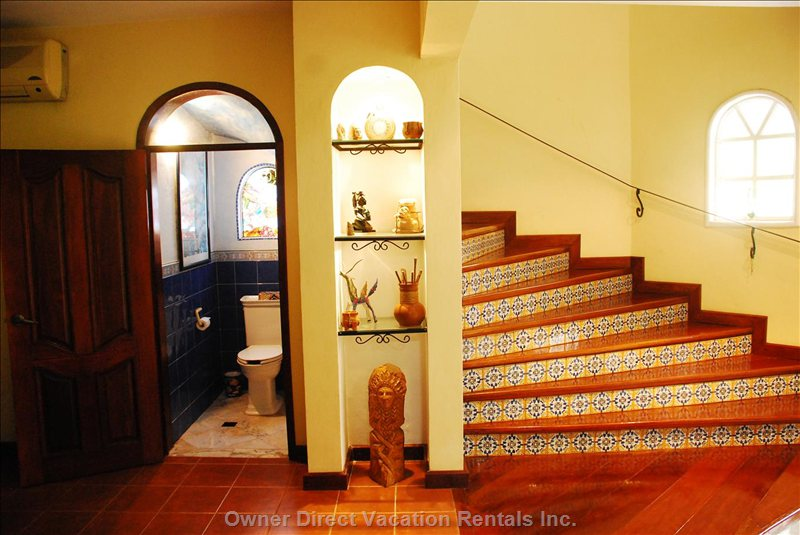 Imported Spanish Tiles Line the Staircase in the Main House