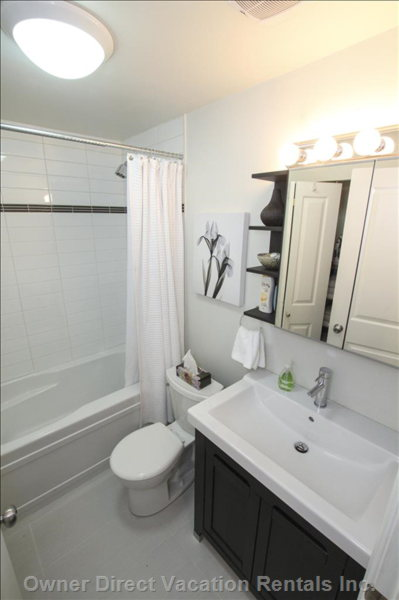 Bathroom with Tub, Shower, and Washer and Dryer for your Laundry in the Closet