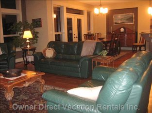 Great Room - Living Room to Dining Room - Very Comfortable Leather Chairs. Antique Dining Table and Chairs.