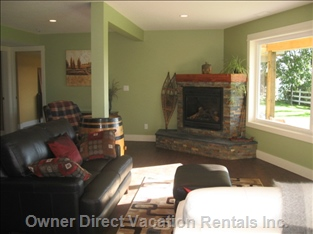 Tastefully Decorated Great Room with a Stone Fireplace to Snuggle up to after Skiing