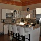 Beautiful Open Kitchen to Dining/Living Area. Homes Comes with all House Wares and Linens.