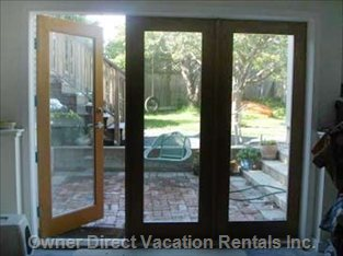 Walk-out French Doors Leading to Sunny, Private Brick Patio.