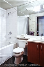 Bathroom with Silestone Countertops and Curved Shower Rod
