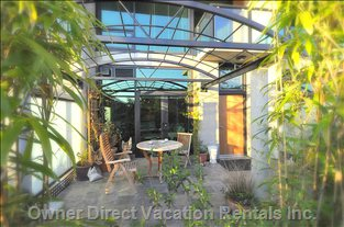 Patio on Ground Floor - this Slate Patio with Private Gas Barbeque is Enclosed and Made Private by a Zen Bamboo Garden.