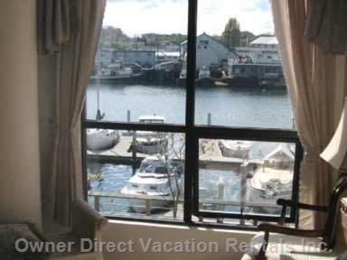 Bedroom View of the Wharf below Where the little Harbour Water Taxis Stop for Rides Or Tours